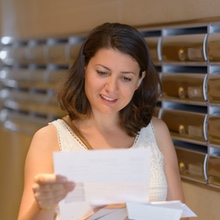 home-woman reading mail